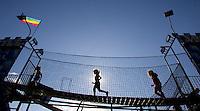 "Goshen, Conn. - 31 August 2008- From left, Kamryn Harkin, 4, of Woodbridge, Ashley Chase, 6, of Torrington, and Emily Alfieri, 8, of Torrington cross a bridge at the ""Castle-Mania"" attraction at 96th annual Goshen Fair."