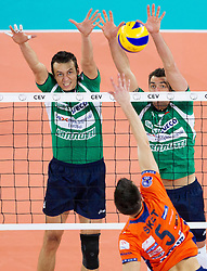 Emanuel Kohut and Wout Wijsmans of Cuneo vs Alen Sket of ACH during volleyball match between ACH Volley Ljubljana and Bre Banca Lannutti Cuneo (ITA) in Playoff 12 game of CEV Champions League 2012/13 on January 15, 2013 in Arena Stozice, Ljubljana, Slovenia. (Photo By Vid Ponikvar / Sportida.com)