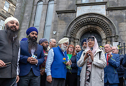 A Peace vigil has been held at a Sikh temple in the Leith district of Edinburgh. The vigil, called by the Muslim Women's Association of Edinburgh and supported by Stand up to Racism Edinburgh, follows a fire at the temple. A 49 year-old man has been charged over the incident.<br /> <br /> Pictured: A speaker from the Muslim Women's Association of Edinburgh during the vigil.