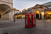 Covent Garden Market, normally crowded with  tourists and shoppers, was deserted at 6.00pm Saturday night during the Coronavirus pandemic on 4th April 2020 in London, United Kingdom. The government clampdown includes the closure of most shops, bars and theatres throughout the country.