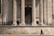 A man walks beneath the pillars and column architecture of Sir Christopher Wren's St Paul's Cathedral south transept, on 24th June 2021, in London, England. (Photo by Richard Baker / In Pictures via Getty Images) CREDIT RICHARD BAKER.