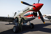 Living historian with Curtiss P-40 Warhawk of the Erickson Aircraft Collection.