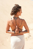 """Beautiful yogini wearing sacred energies by Art Medicine Adornment.<br /> :::<br /> """"I believe in intuition and inspiration. Imagination is more important<br /> than knowledge. Knowledge is limited, whereas imagination<br /> embraces the entire world, stimulating progress, giving birth to evolution.""""<br /> -Albert Einstein"""