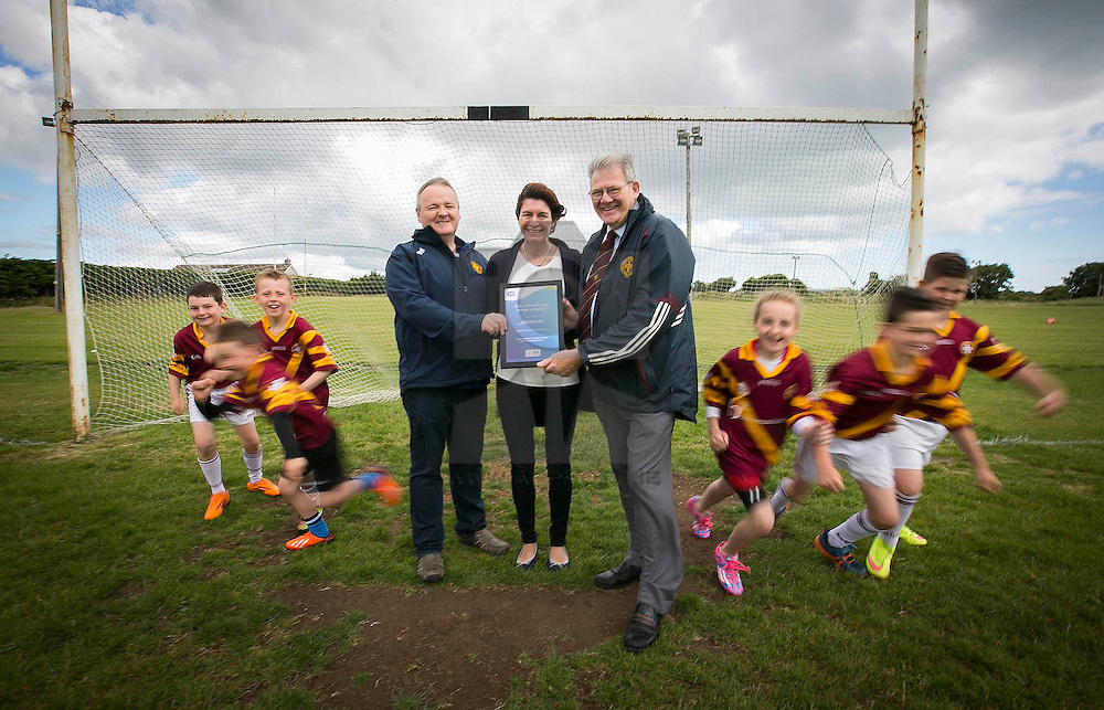 Repro Free: Dublin July 2015: ESB, Official Energy Partner to the GAA, presents St Maur's GAA Club in Rush with a cheque for €1,500. The prize is part of ESB's GAA Fund whereby ESB staff members nominated a local GAA club that is making a difference in the community. Over the coming weeks, a grand total of €30,000 will be awarded to twenty GAA clubs across the country. <br /> <br /> St Maur's GAA Club was nominated for the award by ESB staff member Geraldine Heavey.<br /> <br /> Pictured at the presentation in the club is Peter Monks, club secretary (left), Geraldine Heavey from ESB and Gerry Foley Club Chairman with junior club members . Picture Andres Poveda<br /> <br /> ENDS<br /> <br /> For further information, please contact:<br /> Wilson Hartnell<br /> Rachel Solon / Sarah Gallagher<br /> rachel.solon@ogilvy.com / sarah.gallagher@ogilvy.com    <br /> 01 6690030 / 087 6245326 / 086 3517969
