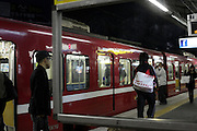 railway commuters after dark Japan Tokyo