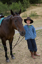 United States, Montana, Livingston, boy (age 8) with horse at dude ranch  MR
