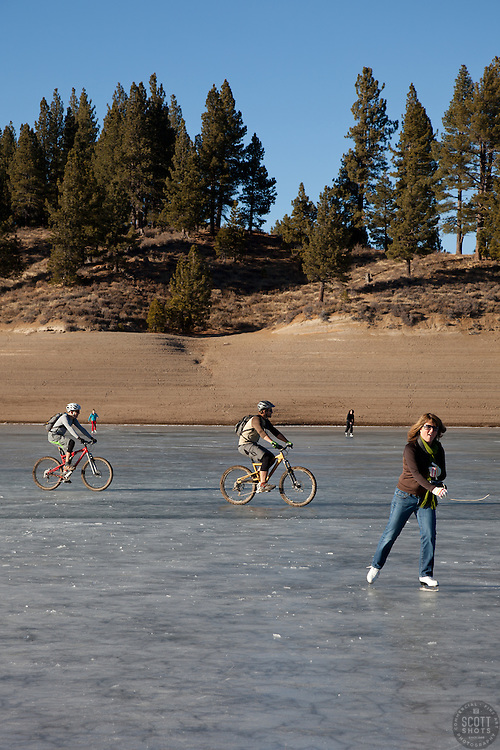 """""""Ice skaters and bikers on Prosser Reservoir 1"""" - These ice skater and mountain bikers were photographed on a frozen Prosser Reservoir, Truckee."""