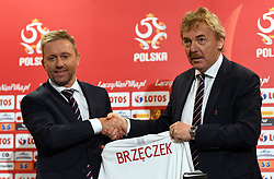 WARSAW, July 24, 2018  Jerzy Brzeczek (L), new head coach of Polish national football team, shakes hand with Zbigniew Boniek, head of Polish Football Association, as he receives a Polish national team jersey with his name on it during a press conference in Warsaw, Poland, July 23, 2018. (Credit Image: © Maciej Gillert/Xinhua via ZUMA Wire)