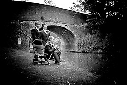 Quirky photo of the Groom and his Groomsmen fishing on his wedding day at Dodmoor House