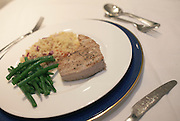 Fresh Maldives line caught yellow fin tuna steaks are served grilled with green haricot beans in a London home