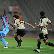 Trabzonspor's Deguy Alain Didier ZOKORA (L) during their UEFA Champions League third qualifying round, second leg, soccer match Trabzonspor between Benfica at the Ataturk Olimpiyat Stadium at İstanbul Turkey on Wednesday, 03 August 2011. Photo by TURKPIX