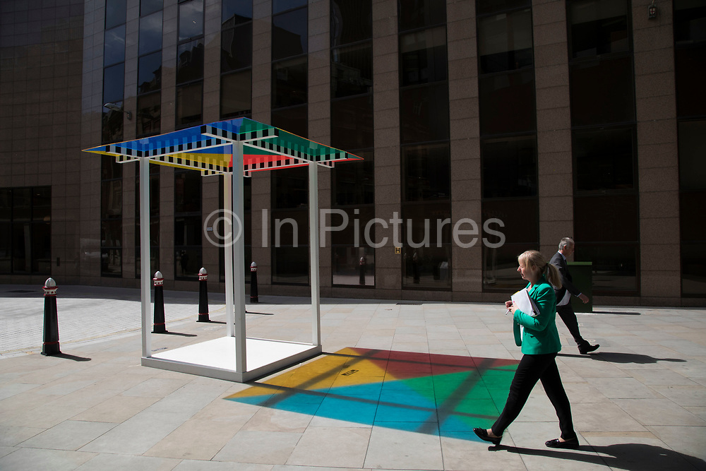 Sculpture in the City on July 17th 2017 in the City of London, England, United Kingdom. Each year, the critically acclaimed Sculpture in the City returns to the Square Mile with contemporary art works from internationally renowned artists in a public exhibition of artworks  open to everyone to come and interact with and enjoy. 4 Colours at 3 Metres High Situated Work by Daniel Buren 2011.