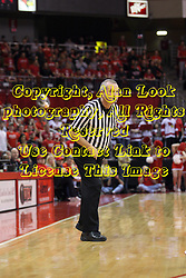 13 February 2013:  referee Hal Lusk peers in on the action during an NCAA Missouri Valley Conference mens basketball game where the Bradley Braves were defeated by Illinois State Redbirds 79-59 in Redbird Arena, Normal IL