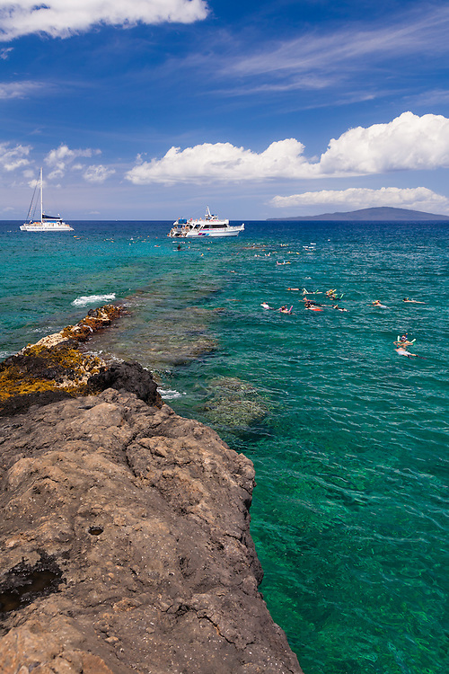 Snorkeling charters deliver tourists by the boat load to south Maui reefs, many of them are accessible by land.