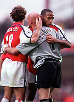 Thierry Henry and Gilles Grimand (Arsenal) console Manchester United goalkeeper Fabien Barthez after the match . Arsenal 1:0 Manchester United, F.A.Carling Premiership, 1/10/2000. Credit Colorsport / Stuart MacFarlane.