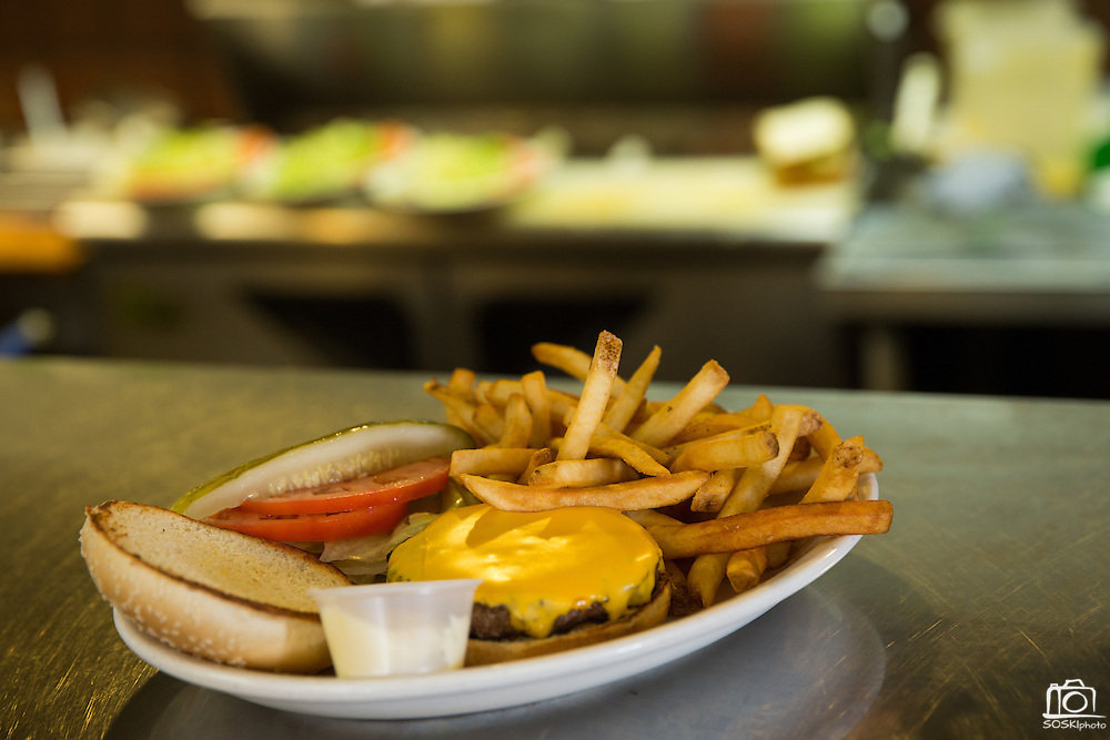A cheeseburger sits in the kitchen window waiting delivery at Mil's Diner in Milpitas, California, on September 12, 2014. (Stan Olszewski/SOSKIphoto)