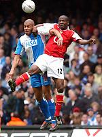 Photo. Daniel Hambury, Digitalsport<br /> Arsenal v Blackburn Rovers. <br /> FA Cup Semi Final.<br /> 16/04/2005.<br /> Arsenal's Lauren and Blackburn Rovers' Steven Reidbattle for the ball.