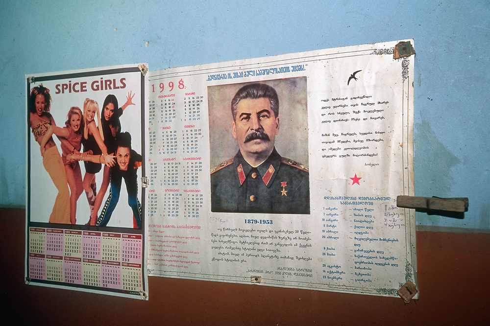 Spice Girls calendar and Stalin calendar found posted side by side in the hallway of a rural motel, The Country of Georgia
