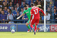 AFC Wimbledon goalkeeper Tom King (1) clearing the ball during the EFL Sky Bet League 1 match between AFC Wimbledon and Scunthorpe United at the Cherry Red Records Stadium, Kingston, England on 15 September 2018.