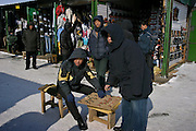 Khabarovsk, Russia, 03/03/2004.&#xD;Traders at the Chinese market on the edge of the city.  Many Chinese cross the nearby border to sell cheap goods on the street and at markets.<br />