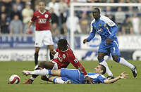Photo: Aidan Ellis.<br /> Wigan Athletic v Manchester United. The Barclays Premiership. 14/10/2006.<br /> Wigan's Paul Scharner tackles United's louis Saha