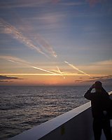 Jet Contrails as the Sun Rises over the North Atlantic Ocean from the Deck of MV Explorer. Image taken with a Leica X2 camera (ISO 100, 24 mm, f/5.6, 1/250 sec).