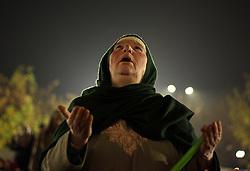 November 21, 2018 - Srinagar, Jammu and Kashmir, India - A Kashmiri Muslim woman prays before the dawn prayers during the ceremony marking the birthday anniversary of Prophet Mohammad, Mawlid al Nabi, at the Hazartabal shrine in Srinagar. (Credit Image: © Faisal Khan/ZUMA Wire)