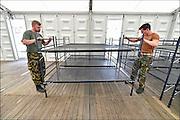 Nederland, Nijmegen,29-6-2015De voorbereidingen voor de nijmeegse vierdaagse zijn weer begonnen met de opbouw van het militair kamp op Heumensoord. De tenten worden geleverd door de Boer tentenbouw en geplaatst door vooral vakantiewerkers en seizoenskrachten. Er komen zo'n 5000 militairen uit verschillende landen te logeren. De 4-daagse vindt plaats in de derde week van juli. Ook militairen van de landmacht zijn al bezig met het aanleggen van de installaties. Foto: Flip Franssen/Hollandse Hoogte The International Four Day Marches Nijmegen (or Vierdaagse) is the largest marching event in the world. It is organized every year in Nijmegen mid-July as a means of promoting sport and exercise. Participants walk 30, 40 or 50 kilometers daily, and on completion, receive a royally approved medal, Vierdaagsekruisje. The participants are mostly civilians, but there are also a few thousand military participants. The maximum number of 45,000 registrations has been reached. More than a hundred countries have been represented in the Marches over the years. FOTO: FLIP FRANSSEN/ HOLLANDSE HOOGTE