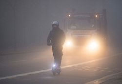 © Licensed to London News Pictures. 05/11/2020. London, UK. A man on an electric scooter makes his way through thick fog in Kensal Green, West London, on the fist day of a new national lockdown. Strict measures have been re-introduced in an attempt to fight a second wave of the COVID-19 strain of Coronavirus. Photo credit: Ben Cawthra/LNP