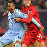 NEW YORK, NEW YORK - November 06: Mark Bloom #28 of Toronto FC is challenged by Khiry Shelton #19 of New York City FC during the NYCFC Vs Toronto FC MLS playoff game at Yankee Stadium on November 06, 2016 in New York City. (Photo by Tim Clayton/Corbis via Getty Images)