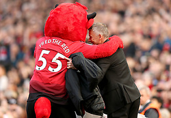 Manchester United caretaker manager Ole Gunnar Solskjaer (right) hugs the Manchester United Mascot Fred the Red prior to the beginning of the Premier League match at Old Trafford, Manchester.