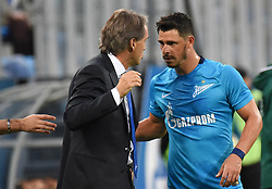 August 3, 2017 - St. Petersburg, Russia - Russia. St. Petersburg. August 3, 2017. The head coach Roberto Mancini and the player of F.C. Zenit Zhuliano during the match of the UEFA Europa League between the Zenit teams (Russia, St. Petersburg) and ''Bney Iyeguda' (Credit Image: © Andrey Pronin via ZUMA Wire)