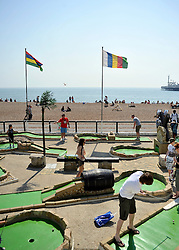 © licensed to London News Pictures. BRIGHTON  UK. 21/04/11. People play crazy golf. People flock to Brighton Beach today to catch the sunshine before the start of the Easter Bank Holiday in Britain. Temperatures are set to continue to rise over the weekend. Photo credit should read Stephen Simpson/LNP