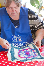 Felt making class for people with a visual impairment - looking at felted wool design.