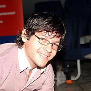 NLD/Amsterdam/20051208 - BN´ers beschilderen Martinair vliegtuigstoelen, actie Pimp my Chair voor de veiling SOS Kinderdorpen, Percy Irausquin