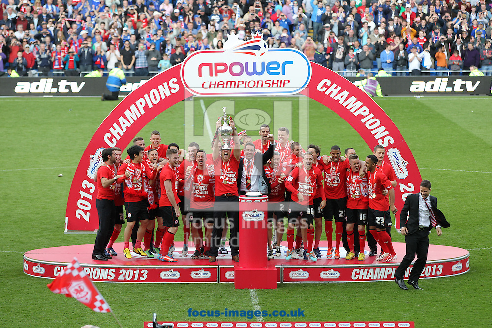 Picture by Mike  Griffiths/Focus Images Ltd +44 7766 223933.27/04/2013.Cardiff City are presented with the Championship Trophy at the npower Championship match at the Cardiff City Stadium, Cardiff.