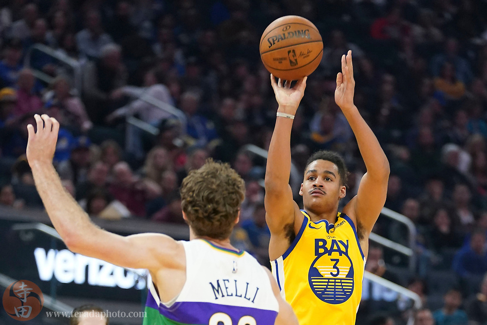 February 23, 2020; San Francisco, California, USA; Golden State Warriors guard Jordan Poole (3) shoots the basketball against New Orleans Pelicans forward Nicolo Melli (20) during the second quarter at Chase Center.