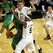 Central Florida guard Marcus Jordan (5) defends Marshall guard DeAndre Kane (24) during a Conference USA NCAA basketball game between the Marshall Thundering Herd and the Central Florida Knights at the UCF Arena on January 5, 2011 in Orlando, Florida. Central Florida won the game 65-58 and extended their record to 14-0.  (AP Photo/Alex Menendez)