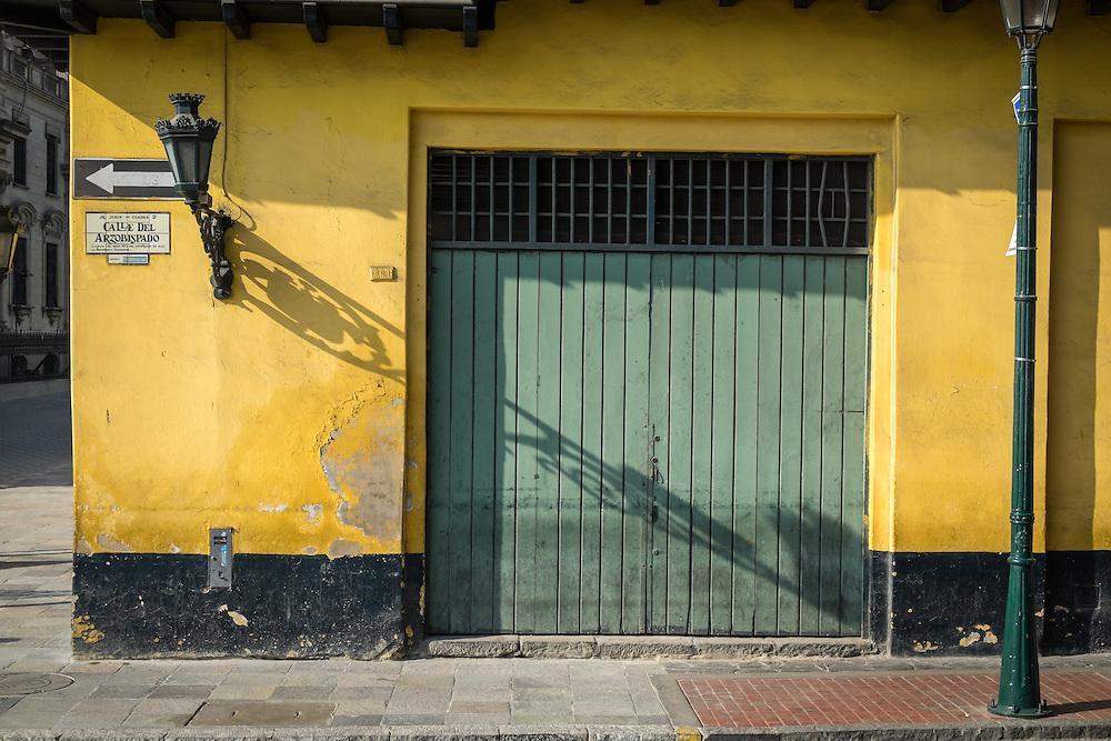 View of facade in Calle del Arzobispado in the Lima Historic Centre in Peru