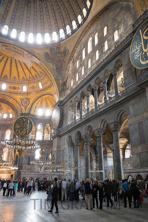 Tourists at Hagia Sophia, Ayasofya Muzesi, mosque museum former Greek Orthodox church in Sultanahmet, Istanbul, Turkey