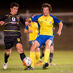 BRISBANE, AUSTRALIA - AUGUST 26: Jeremy Stewart of the Strikers and Matthew Capelo of Moreton Bay compete for the ball during the NPL Queensland Senior Men's Semi Final match between Brisbane Strikers and Moreton Bay Jets at Perry Park on August 26, 2017 in Brisbane, Australia. (Photo by Patrick Kearney)