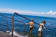 2 girls going into the sea for a swim , Slovenia Visit our PHOTO COLLECTIONS OF SLOVANIAN  HISTOIC PLACES for more photos to download or buy as wall art prints https://funkystock.photoshelter.com/gallery-collection/Pictures-Images-of-Slovenia-Photos-of-Slovenian-Historic-Landmark-Sites/C0000_BlKhcYWnT4Sites/C0000qxA2zGFjd_k