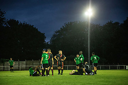 © Licensed to London News Pictures. 30/07/2021. Manchester, UK.  Players gather following a football match between Greater Manchester Fire and Rescue vs Grenfell Athletic in Manchester. The match forms part of a tour in which Grenfell will also take on Fire Services in Newcastle, Liverpool and London, with donations raised at the matches going towards the future of the club. Photo credit: Ryan Jenkinson/LNP