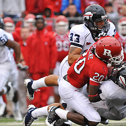 Sep 12, 2009; Piscataway, NJ, USA; Howard running back Andra Williams (4) is tackled by Rutgers cornerback Khaseem Greene (20) while returning a kickoff during the first half of Rutgers' 45-7 victory over Howard in NCAA College Football at Rutgers Stadium.