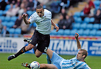 Photo: Leigh Quinnell.<br /> Coventry City v Luton Town. Coca Cola Championship.<br /> 29/10/2005. Coventrys James Scowcroft slides into Lutons Dean Morgan.