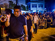 30 MARCH 2018 - BANGKOK, THAILAND: Thais carry a cross to symbolize Jesus' walk to the crucifixion during Good Friday observances at Santa Cruz Church in the Thonburi section of Bangkok. Santa Cruz Church is more than 350 years old and is one of the oldest Catholic churches in Thailand. Good Friday is the day that most Christians observe as the crucifixion of Jesus Christ. Thailand has a small Catholic community.       PHOTO BY JACK KURTZ
