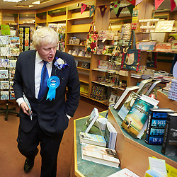 © Licensed to London News Pictures.  02/05/2015. ABINGDON, UK. Boris Johnson tries and fails to find a copy of his book The Churchill Factor in an independent bookshop while campaigning in Abingdon with Nicola Blackwood (not seen) who is standing for re-election as MP for the Oxford West and Abingdon constituency. Photo credit: Cliff Hide/LNP