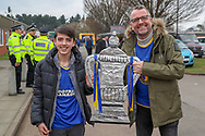 AFC Wimbledon fans with the cup during the The FA Cup 5th round match between AFC Wimbledon and Millwall at the Cherry Red Records Stadium, Kingston, England on 16 February 2019.