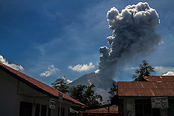 May 25, 2017 - Sinabung volcano spews rolling thick volcanic ash into the air, as seen from Tiga Pancur village on May 25, 2017, North Sumatra province, Indonesia. The activity of Mount Sinabung with the status of Awas (Level IV) increases which volcanic earthquakes have continued to occur with erruptions creating an ash cloud of about 4,000 meters height. Mount Sinabung is one of the most active volcano in Indonesia. (Credit Image: © Ivan Damanik via ZUMA Wire)