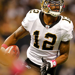 October 23, 2011; New Orleans, LA, USA; New Orleans Saints wide receiver Marques Colston (12) against the Indianapolis Colts during the first half of a game at the Mercedes-Benz Superdome. Mandatory Credit: Derick E. Hingle-US PRESSWIRE / © Derick E. Hingle 2011